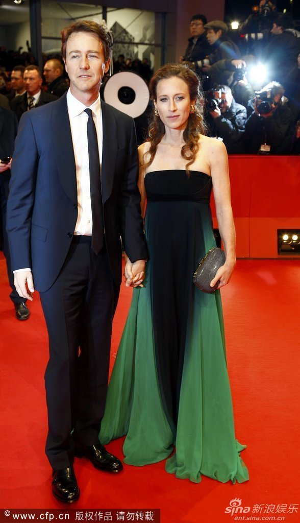 """Cast member Norton and his wife Robertson arrive for the screening of the movie """"The Grand Budapest Hotel"""" during the 64th Berlinale International Film Festival in Berlin"""